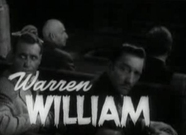 Warren William as Dr Lloyd - Ralph Bellamy at left