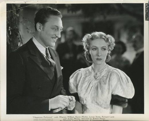 Warren William with Karen Morley in Outcast