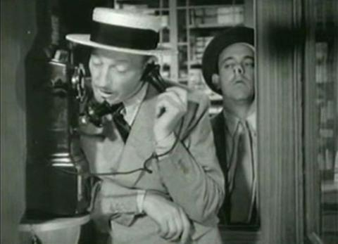 Warren William and Allen Jenkins in The Case of the Lucky Legs