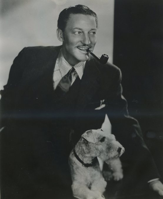 Warren William with his wire hair terrier 1938