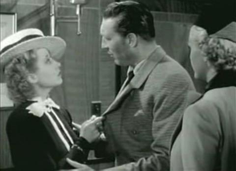 Genevieve Tobin and Warren William in The Case of the Lucky Legs