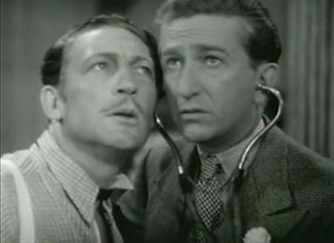 Warren William and Olin Howard in The Case of the Lucky Legs